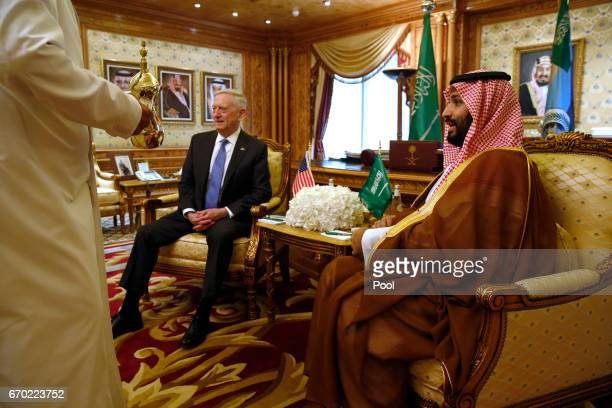 A servant brings tea as Saudi Arabia's Deputy Crown Prince and Defense Minister Mohammed bin Salman welcomes US Defense Secretary James Mattis on...