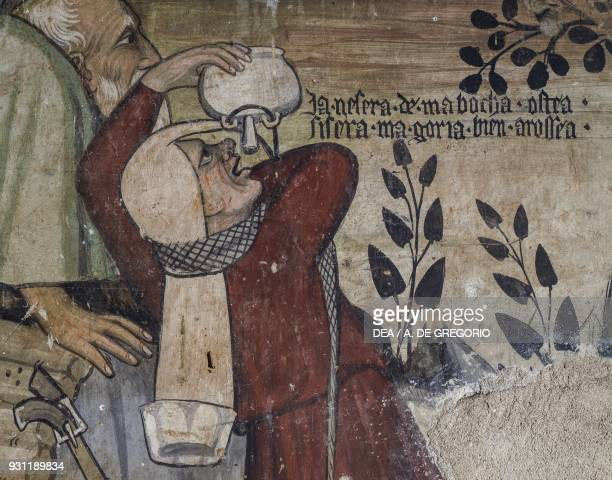 Servant drinking from a kind of a hip flask detail from the Fountain of Youth fresco in the Baronial Hall Castle of Manta Saluzzo Piedmont Italy 15th...
