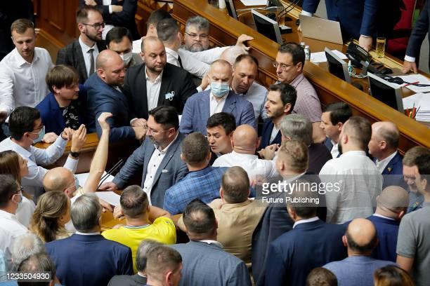 Servant of the People MP Mykola Tyshchenko and OPZZh MP Illia Kyva brawl during a plenary sitting of the Ukrainian parliament, Kyiv, capital of...