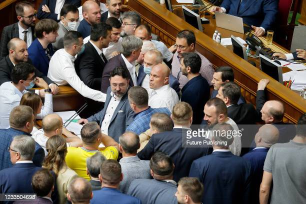 Servant of the People MP Mykyta Poturaiev and OPZZh MP Illia Kyva are pictured during a plenary sitting of the Ukrainian parliament, Kyiv, capital of...