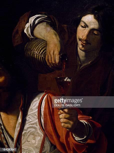 Servant pouring wine detail of Meeting of drinkers by Nicolas Tournier oil on canvas 129x192 cm Le Mans Musée De Tessé