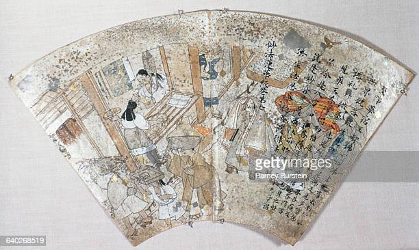Servants at Work from a Heian Period FanShaped Album of Hokekyo Sutra