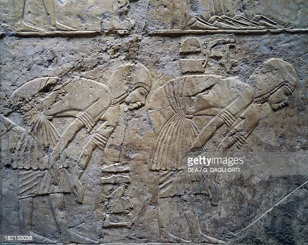 Servants bowing at a hearing relief Tomb of Ramose Vizier during the reigns of Amenhotep III and Akhenaten also known as Tomb TT55 Sheikh Abd elQurna...