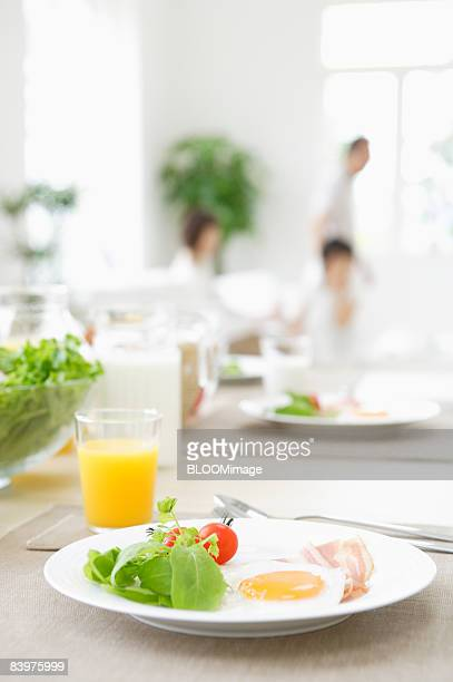 Served table with family in background, focus on foreground