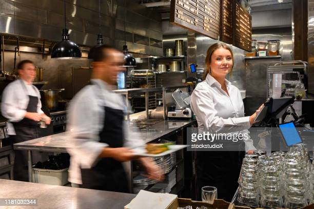 server adding a new order with a tablet - food service occupation stock pictures, royalty-free photos & images