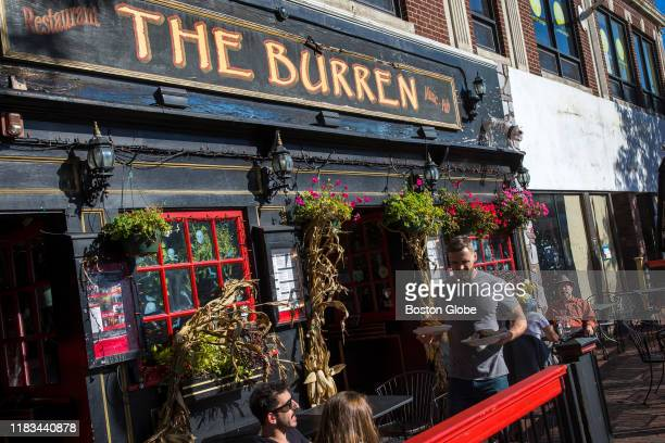 A server brings out food at The Burren in Davis Square in Somerville MA on Oct 24 2019 Today Davis Square still buzzes with 20something energy...
