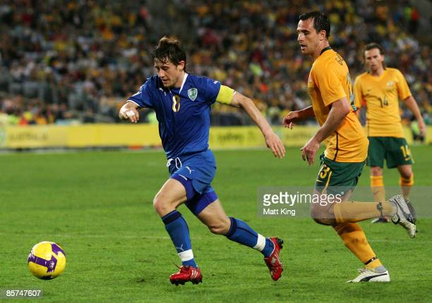 Server Djeparov of Uzbekistan controls the ball in front of Richard Garcia of the Australia during the 2010 FIFA World Cup qualifying match between...