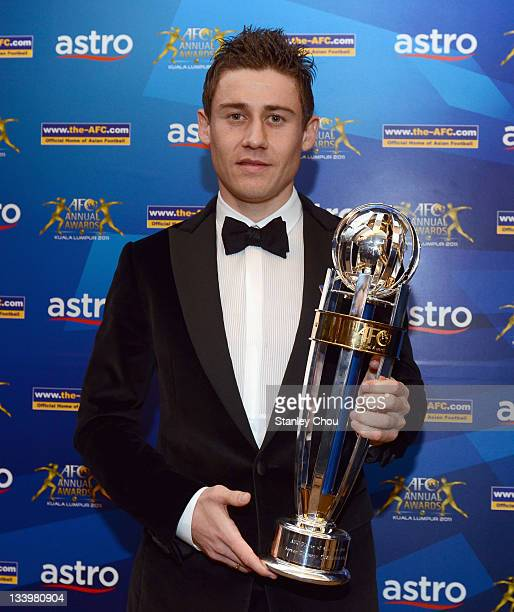 Server Djeparov of Uzbekistan poses with the 2011 AFC Player of the Year Award after he won it during the 2011 AFC Annual Awards at Mandarin Oriental...