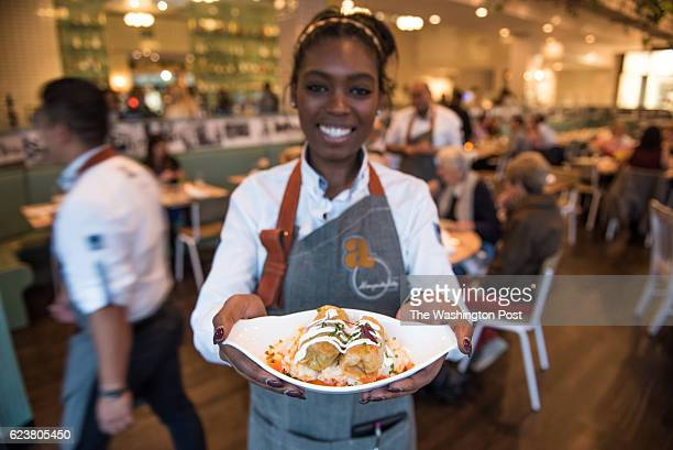 Server Natalie Brito with Stuffed Sour Cabbage potato mash pork belly rice and yogurt at Ambar