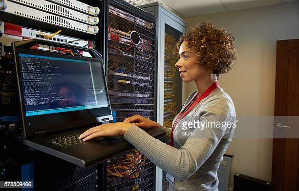 server room it programmer. - information technology support stock photos and pictures