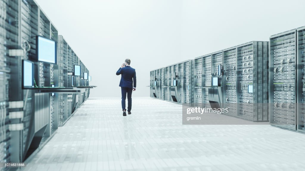 Server room with businessman : Stock Photo