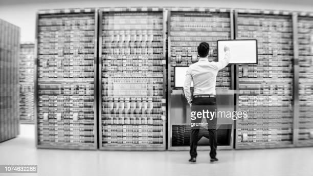 server room with businessman - big data storage stock pictures, royalty-free photos & images