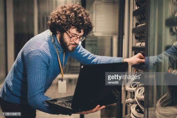 server rooms-it engineer at workplace - firewall stock pictures, royalty-free photos & images