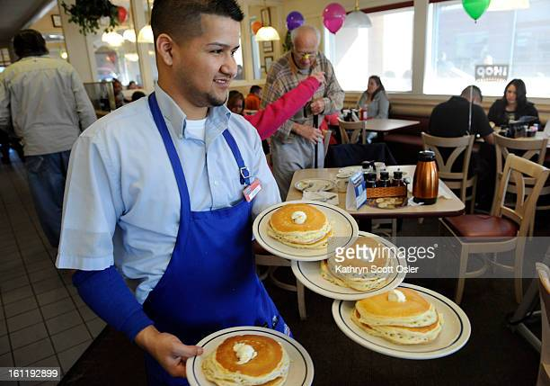 Server Ruben Avalos performs a balancing act with several plates of the free pancakes The International House of Pancakes hosts a National Pancake...