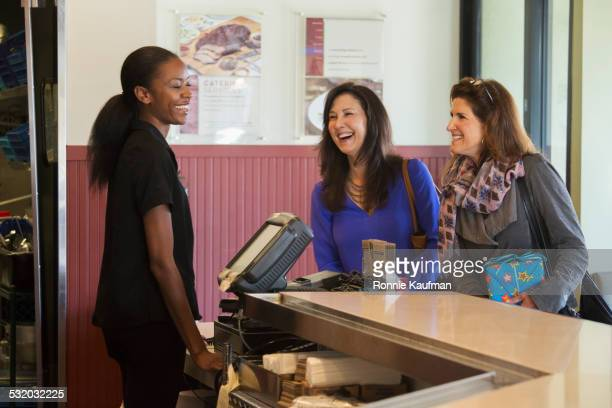 Server talking to customers in restaurant