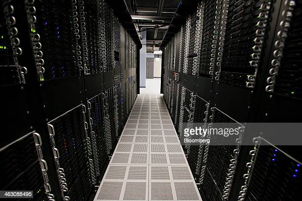 Servers and hard drives stand inside pod one of International Business Machines Corp's Softlayer data center in Dallas Texas US on Thursday Jan 16...