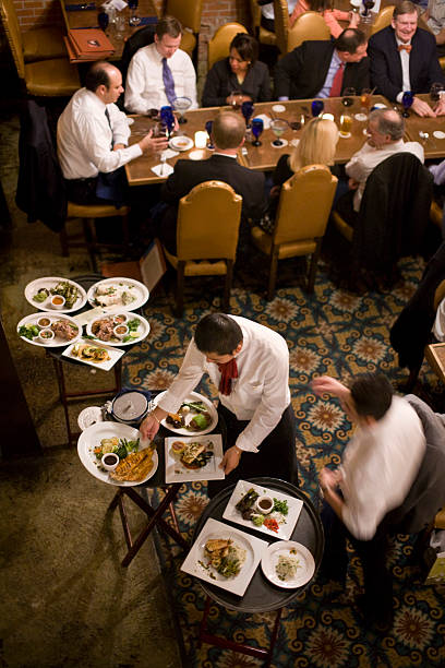 Servers Deliver Food To Tables At Hugos In Houston Texas U