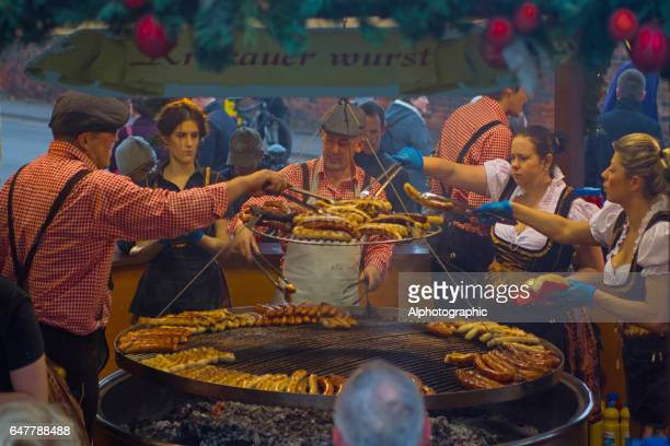 servers on a bratwurst stall - german culture stock pictures, royalty-free photos & images