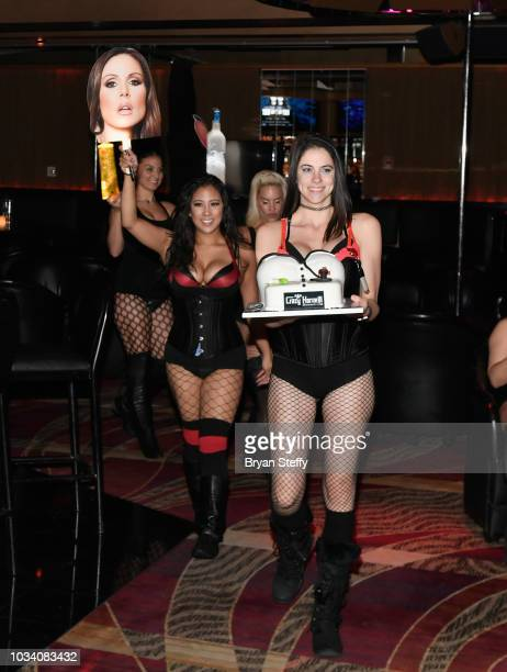 Servers present adult film actress Kendra Lust a birthday cake during her birthday party celebration at Crazy Horse 3 Gentlemen's Club on September...