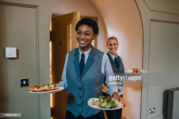 server's serving starters - waiter stock pictures, royalty-free photos & images