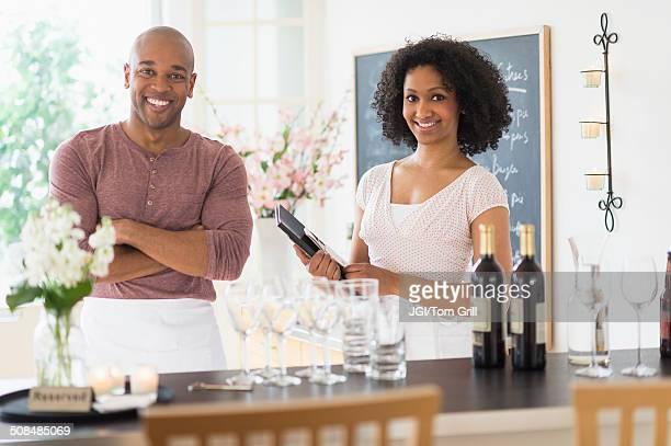 Servers smiling in restaurant