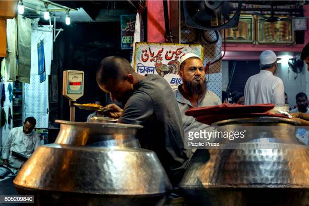 A service boy is collecting Biriyani in a foodjoint opposite to Jama Masjid Jama Masjid situated in one of the most crowded area of New Delhi...