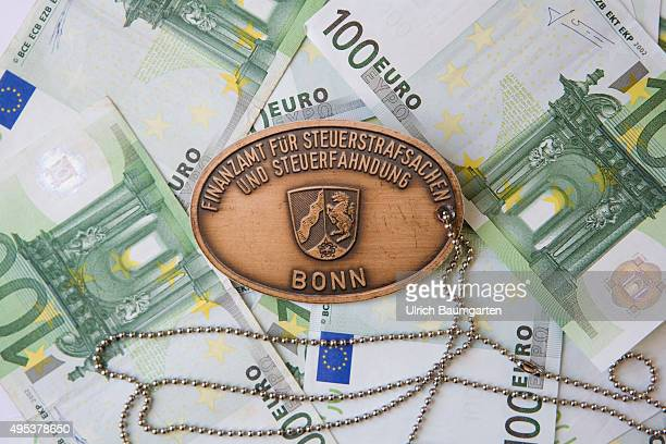 Service brand for criminal tax matters and tax investigation Bonn on 100 Euro banknotes Symbol photo on the subjekt tax evasion black money etc
