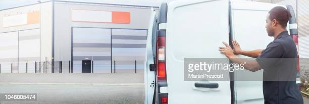 service engineer closing the doors on his van - vehicle door stock pictures, royalty-free photos & images