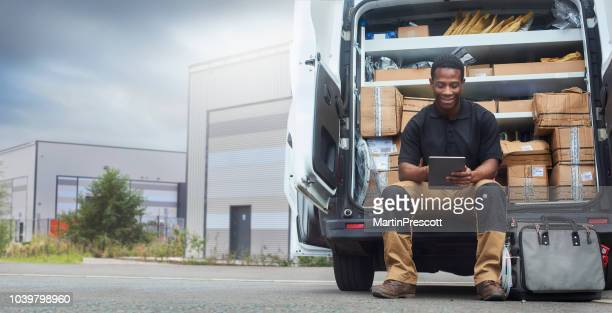 service engineer sat at the back of his van - transportation stock pictures, royalty-free photos & images