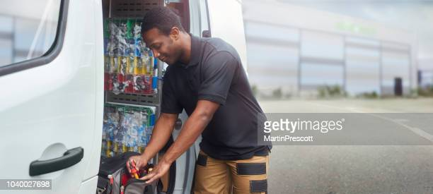 service engineer sorting tools in tool bag - van vehicle stock pictures, royalty-free photos & images