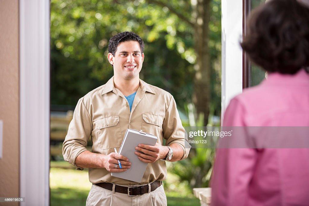 Service Industry: Latin descent repairman at customer's front door. : Stock Photo
