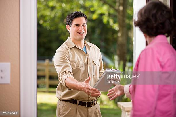 service industry: latin descent repairman at customer's front door. - inspector stock pictures, royalty-free photos & images