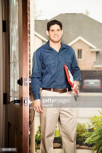 Service Industry: Latin descent salesman at customer's front door.