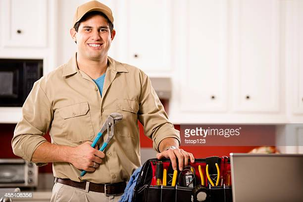 Service Industry:  Latin repairman working at customer's home. Tools.