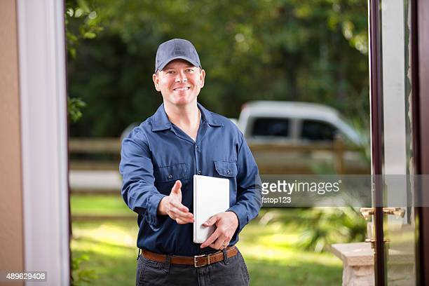 service industry: repairman at customer's front door. digital tablet. handshake. - inspector stock pictures, royalty-free photos & images