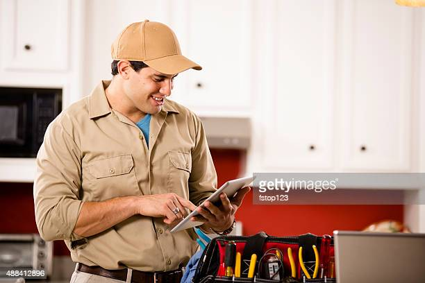 Service Industry:  Repairman working at customer's home. Tools. Digital tablet.