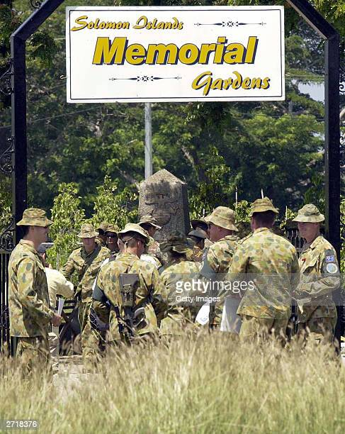 Service men and women from Australia New Zealand Papua Guiena Tonga and Fiji gather November 11 2003 to commemorate Remembrance Day at a small...