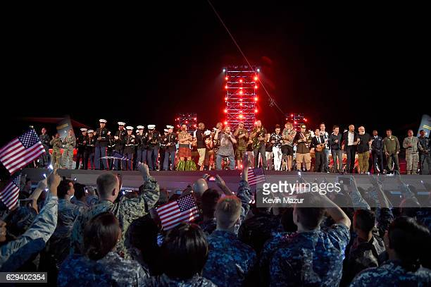 Service men and women join Terry Crews Jack Black Flo Rida Dwayne 'The Rock' Johnson Prince Royce Tommy Counihan Jeff Ross and others onstage during...