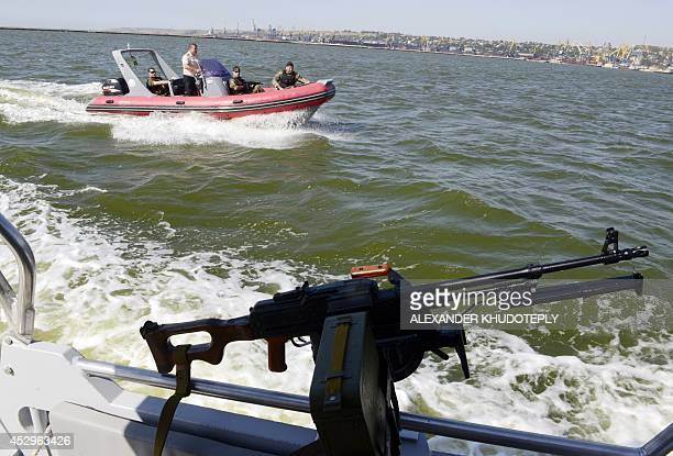 Service men of the maritime security of the State Border Service of Ukraine patrols the sea of Azov off the southern Ukrainian city of Mariupol on...