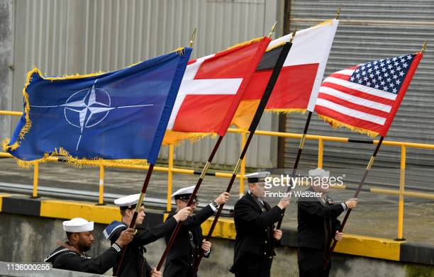 Service men pose for the media with NATO,Denmark, Germany, Poland and U.S.A. Flags at Devonport Naval Base on March 15, 2019 in Plymouth, England....