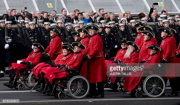 Service personnel parade along Whitehall after the Remembrance Sunday ceremony at the Cenotaph on Whitehall London on November 13 2016 Services are...