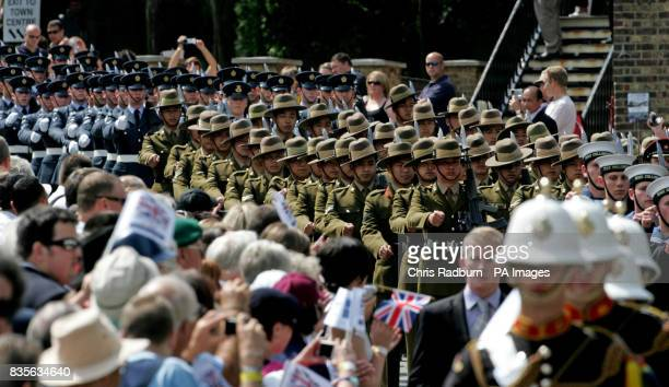 Service personnel parade at the Historic Dockyard in Chatham Kent before a service to mark the first annual Armed Forces Day