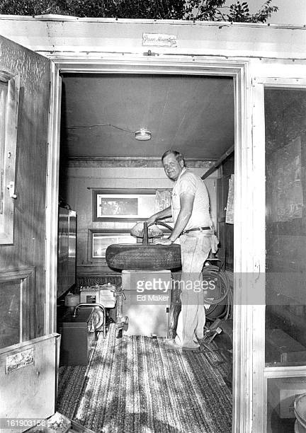 AUG 8 1984 Service Stations Denver Converted to car repair Ed Rice mobile mechanic fixes tire in his truck