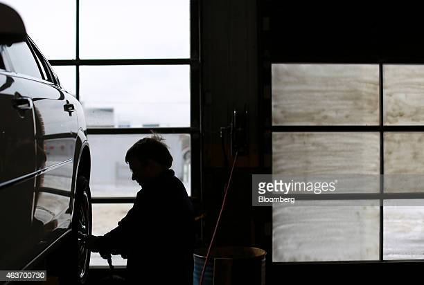 A service technician rotates the tires on a customer's vehicle at a Goodyear Tire and Rubber Co Auto Service Center in Millington Tennessee US on...