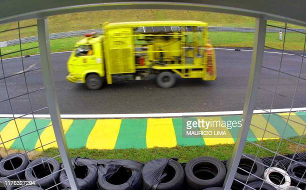 A service truck passes in front of the pit area that will be used in the Brazilian Grand Prix 27 March 2001 in Sao Paulo The Brazilian Grand Prix...