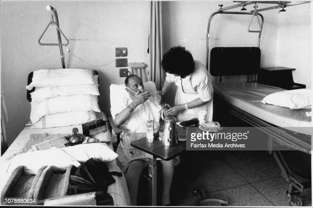 Service with a smile as usual for Kenneth Campbell who receives comfort from Sister Margaret Green at Auburn hospital October 15 1991