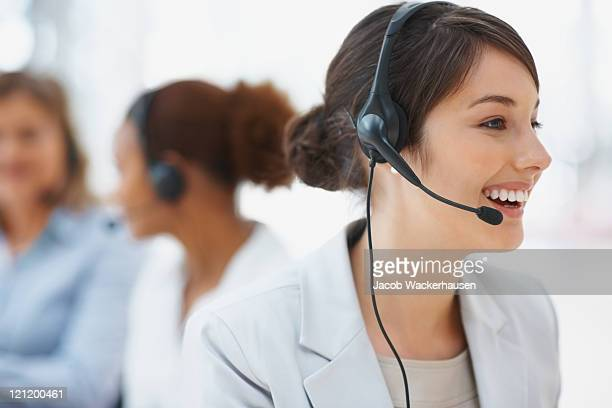 Service with smile - Closeup of pretty call center employee