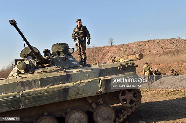 A serviceman attends on Armoured Personnel Carrier on the position of Ukrainian forces on front line near small eastern Ukrainian city of Kurakhove...