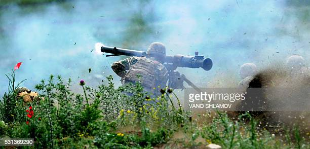 US serviceman fires a weapon during the Noble Partner 2016 joint military exercise at the Vaziani training area outside Tbilisi on May 14 2016...