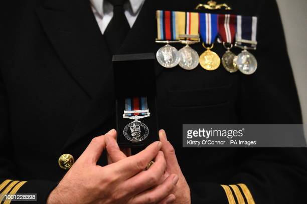 A serviceman holds his new Operation Shader medal which was presented to him for contributing to the coalition fight against Daesh in Iraq and Syria...